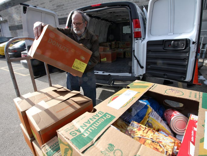 Jerry Karnowski unloades boxes of food that he just