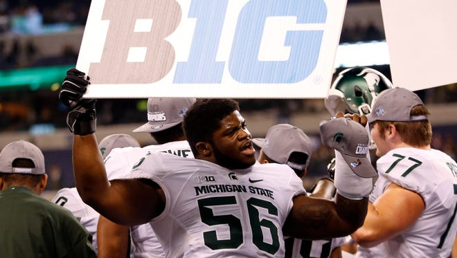 Michigan State's Enoch Smith Jr. (56) celebrates after Michigan State defeated Iowa 16-13 to win  the Big Ten championship NCAA college football game Saturday, Dec. 5, 2015. Smith announced over Twitter he was leaving the program.