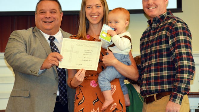 Rev. Bart Kelley (left) presents a certificate and Bible to Valerie, Walker and Hunter Dowis in honor of Walker's baby dedication on Sept. 20, 2020 at Barnwell First Baptist Church.