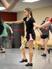 The dancing abilities of bone cancer survivor​ Gabi Shull, of Warrensburg, have inspired many. She works on her tap dancing May 16 at the Center State Academy of the Performing Arts in Warrensburg.
