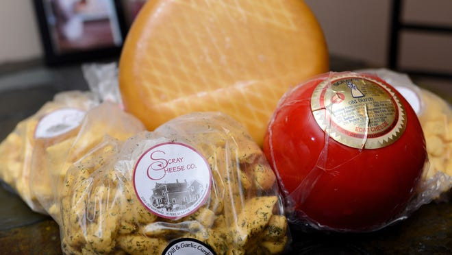 Some of Scray Cheese's popular products include cheese curds, edam (the red ball) and smoked gouda (back).