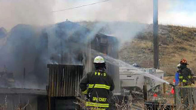 Pueblo West firefighters work to extinguish a structure fire.