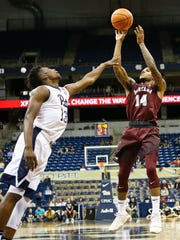 Montana's Ahmaad Rorie (14) will face his cousin, Washington guard David Crisp, in a game Friday night in Seattle.