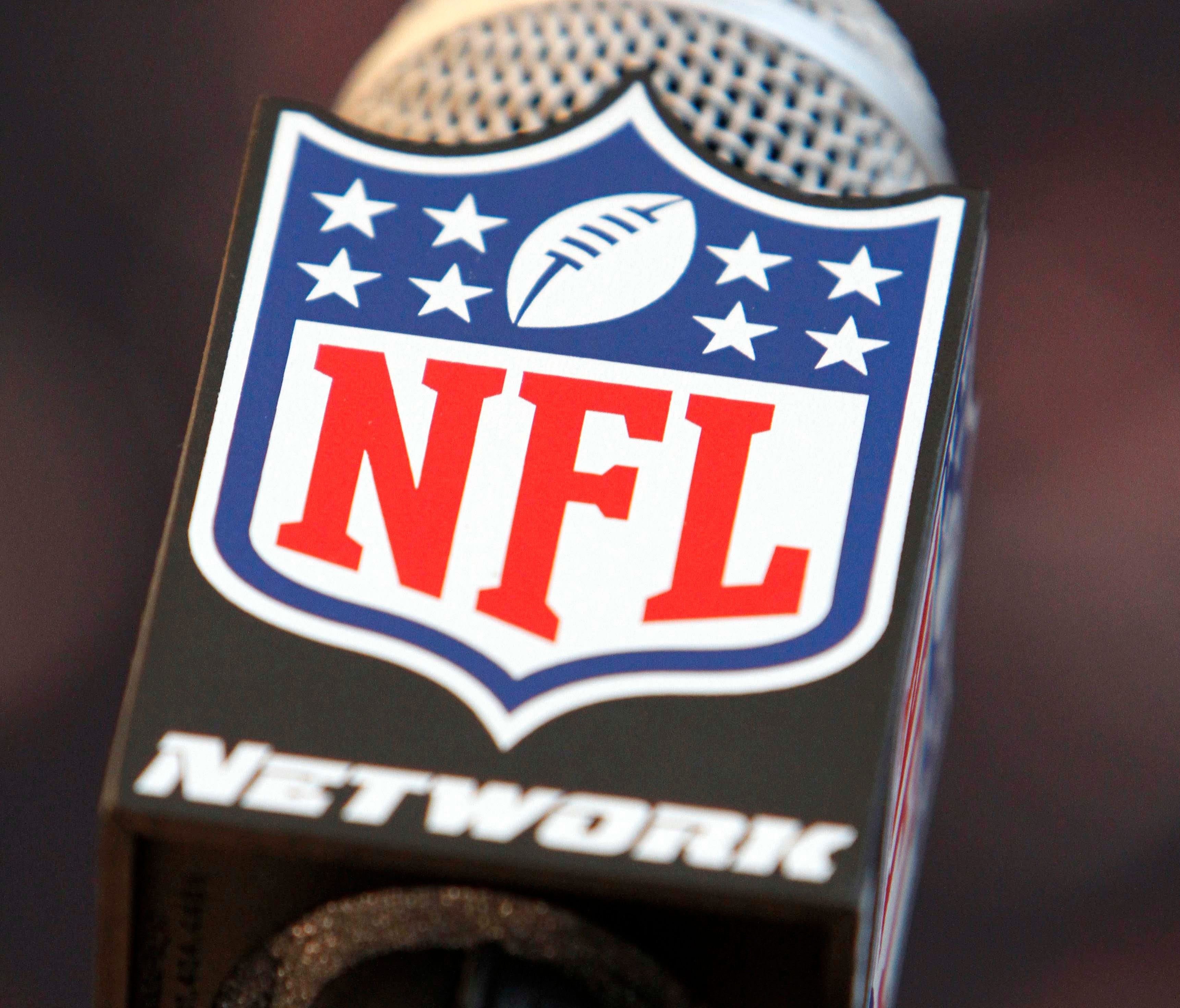Detailed view of a NFL Network microphone during a press conference.