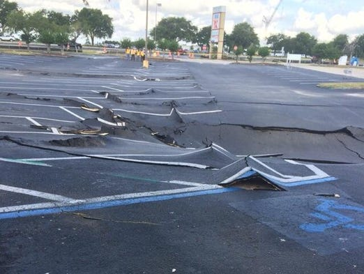 The growing, suspected sinkhole Winter Haven Police say opened Thursday morning in the Publix Parking lot