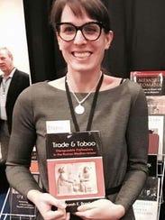 Sarah Bond, a University of Iowa associate professor