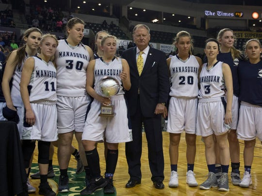 The Manasquan girls basketball team on the court at