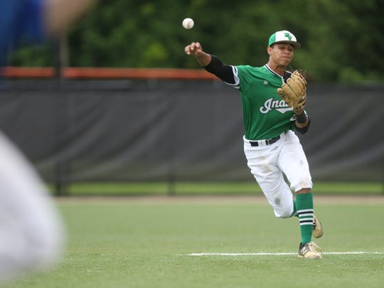 Justin Martin, of Pascack Valley, is unable to get the out at first after fielding a slow ground ball in the seventh inning.