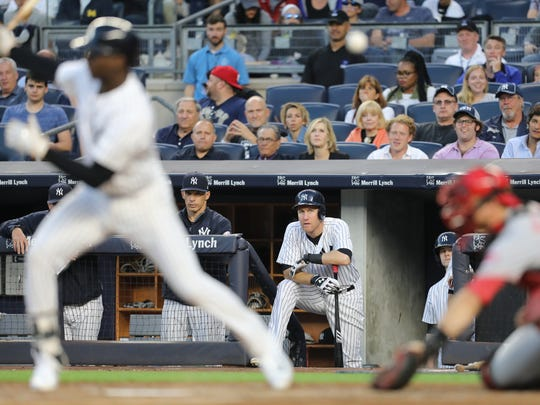 Todd Frazier watches as Didi Gregorius connects for a foul tip against the Reds at Yankee Stadium, Tuesday, July 25, 2017.