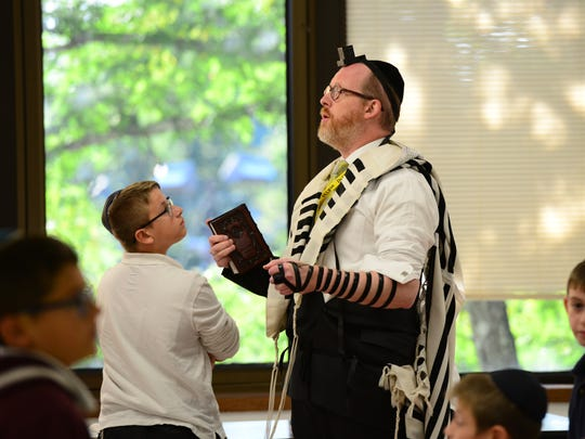 Rabbi Avi Bernstein leads a group of middle school