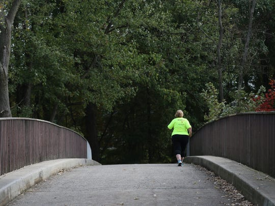 Barbara Brown, 60, of Elmwood Park, who started running eight years ago, is running her fourth New York City Marathon on Sunday.  She is shown here at Saddle River County Park on her final training run before the race. Sunday will be Brown's fifth and final marathon.  She is dedicating her race to her friend, Scott Fleming, who died of ALS in September.  Brown will start with an Achilles wave as she has had three spinal cord tumor surgeries, and suffers from degenerative disc disease and scoliosis.  The tumors still remain in her body. She will be running with a locket that contains some of Flemings ashes.  Thursday, November 2, 2017