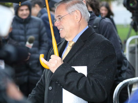 Sen. Bob Menendez leaves the Martin Luther King Jr. Building and U.S. Courthouse in Newark on Tuesday.