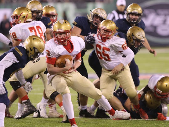 Mount Olive Quarterback, Liam Anderson runs with the
