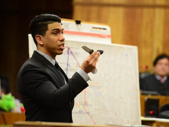 Assistant Prosecutor Jonathan Barrera holds a knife
