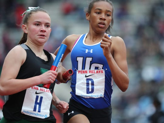 Kaitlyn Van Baalen (H), of Ridge and Zamira Ysaac, of Union Catholic run the anchor legs of the 4x800.  While Van Baalen ran a 2:16.44 leg and Ysaac ran a 2:18.79 leg, Catholic's overall time was 9:10.4 to best Ridge, who finished with an overall time of 9:10.65. Friday, April 27, 2018