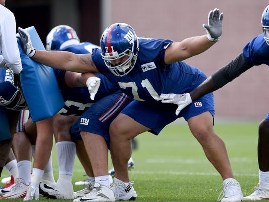 NY Giants Will Hernandez #71 runs drills during the