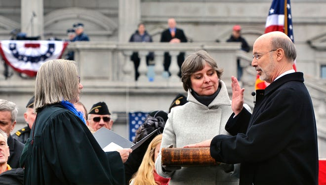Tom Wolf is sworn in as Governor of Pennsylvania during ceremony at the state capitol building in Harrisburg, Tuesday January 20, 2015. John A. Pavoncello - jpavoncello@yorkdispatch.com