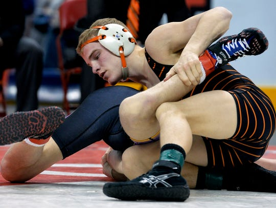 Hanover's Ian Brown, right, wrestles Boiling Springs'