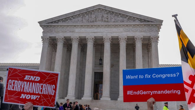 Protesters rallied outside the Supreme Court Wednesday as the justices heard a challenge to Maryland's partisan congressional maps.