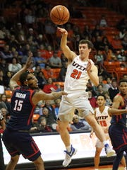 Trey Touchet, 21, of UTEP passes to a teammate under the basket Thursday night.