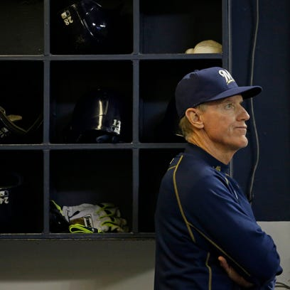 Milwaukee Brewers Manager Ron Roenicke watches the game against the Cincinnati Reds during the seventh inning of a baseball game Monday, April 20, 2015, in Milwaukee.