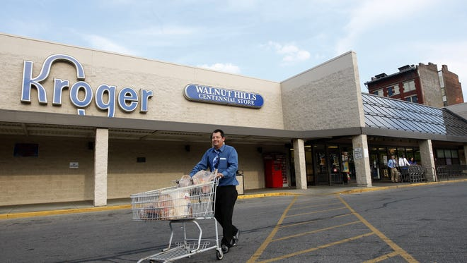 In this 2012 file photo, Dion Day leaves the Kroger store in Walnut Hills.