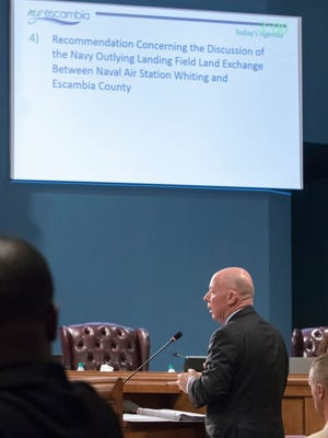 Jim Balocki, deputy assistant secretary of the Navy for installations and facilities, answers questions about the Navy outlying landing field land exchange during an Escambia County Commission meeting on Monday, June 19, 2017.