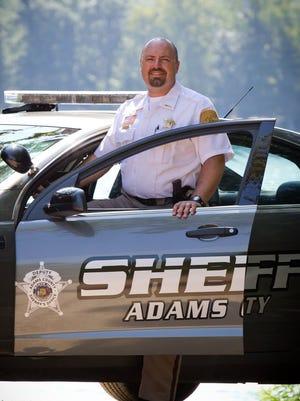 Sam Wollin is the Adams County sheriff.