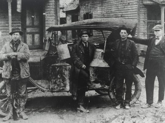 Knox County sheriff's deputies with a confiscated moonshine