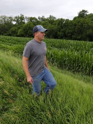 Justin Dammann on his family's Page County farm.