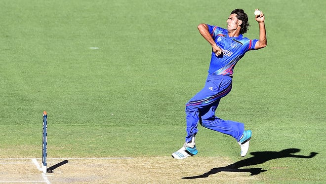 Afghanistan's Shahpur Zadran bowls during the one-day international warm-up cricket match between India and Afghanistan in Adelaide on February 10, 2015.