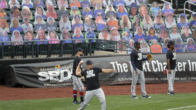 Braves players wear Black Lives Matter shirts while they warm up before Friday's season opener against the Mets at Citi Field in New York. The game was not over at press time. Go to savannahnow.com/sports for coverage.