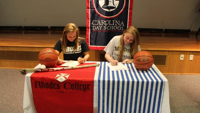 Carolina Day held a signing ceremony Wednesday for seniors Lauren Travis, left, and Hannah Calloway.