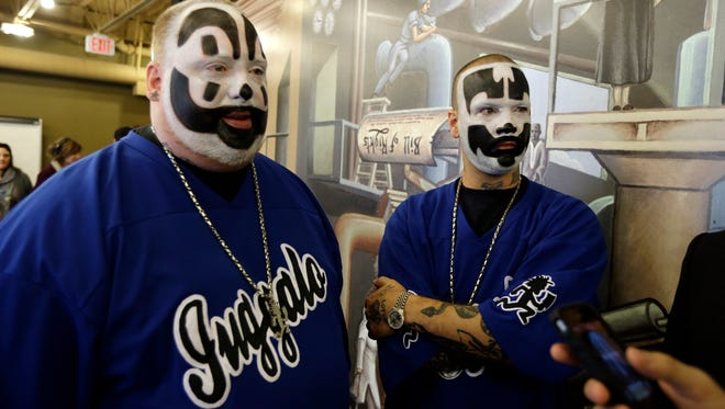 Insane Clown Posse members Joseph Bruce, aka Violent J, left, and Joseph Utsler, aka Shaggy 2 Dope, are seen after a news conference in Detroit on Jan. 8, 2014.