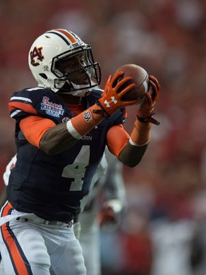 Auburn wide receiver Jason Smith (4) catches a pass during the NCAA football game between Auburn and Louisville on Saturday, Sept. 5, 2015, in at the Georgia Dome in Atlanta, Ga.