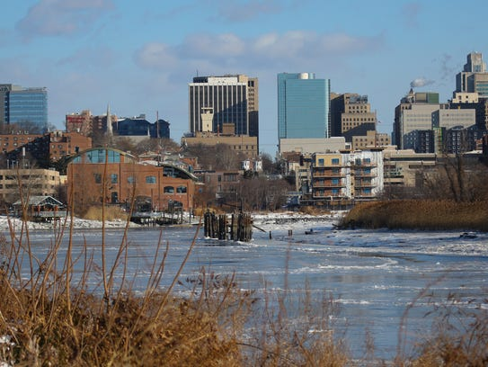 Wilmington shines above the frozen Christina River on Friday morning.