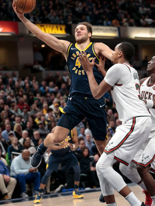 Indiana Pacers forward Bojan Bogdanovic, left, goes to the basket in front of Milwaukee Bucks guard Jason Terry (3) during the second half of an NBA basketball game in Indianapolis, Monday, March 5, 2018. The Pacers won 92-89. (AP Photo/AJ Mast)