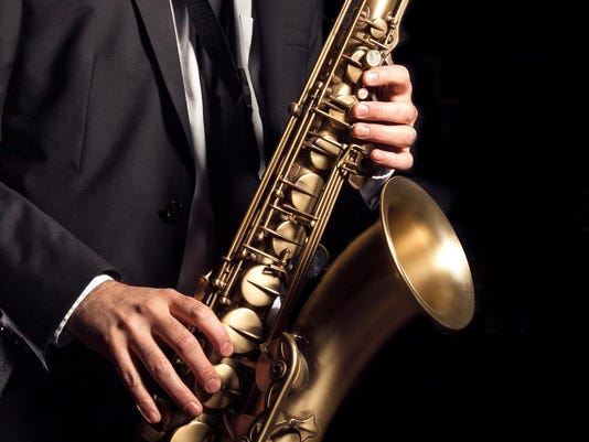 playing a saxophone