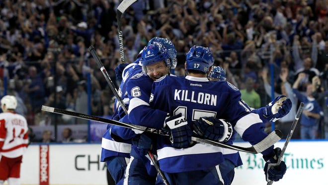 Tampa Bay Lightning defenseman Anton Stralman (6) celebrates with teammates after he scored against the Detroit Red Wings during the third period of the first round of the 2015 Stanley Cup Playoffs at Amalie Arena.