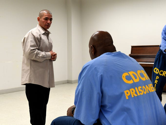 Johnny Placencia speaks to inmates at Salinas Valley