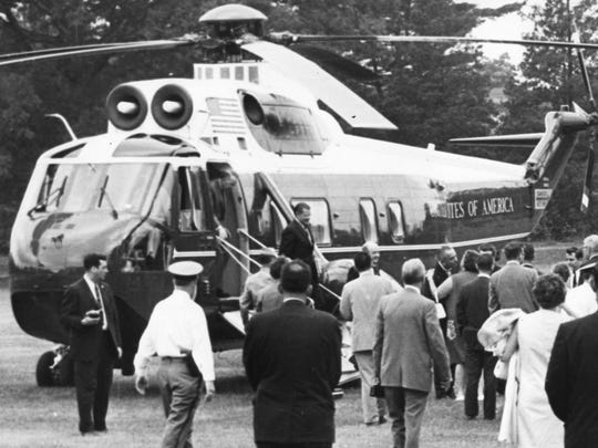 President Johnson kisses the governor's wife, Betty Hughes, after the presidential helicopter lands on the Glassboro State College baseball field for the Hollybush Summit in 1967.
