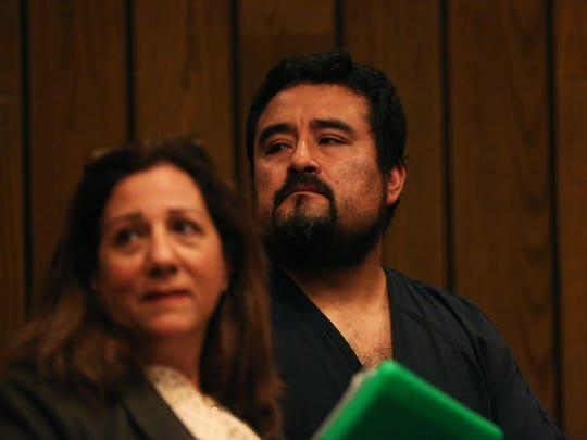 Edgar Lopez-Marin stands with Lina Makarem, a certified court interpreter, during his arraignment at the Shelby County Criminal Justice Center on Nov. 30, 2017.