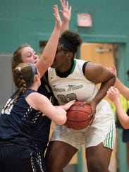 Fort Myers' Chaniya Clark works in the paint  in the