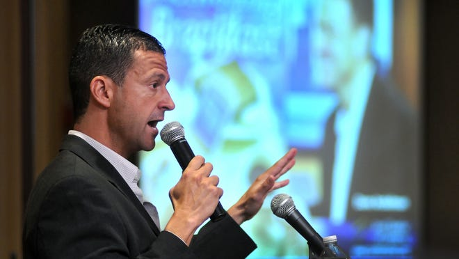 Dave Andelman, founder of the Phantom Gourmet, speaks during the Corridor 9 Chamber of Commerce breakfast at the Doubletree Hotel in Westboro on Aug. 16, 2012.