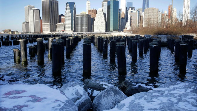 Ice and snow cover rocks on the waterfront in the borough of Brooklyn in New York on Jan. 8.