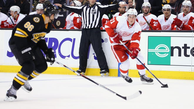 Dylan Larkin moves the puck during Detroit's loss in Boston Saturday night.