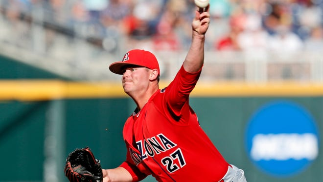 Arizona starting pitcher JC Cloney (27) throws during the game against the Coastal Carolina Chanticleers in game one of the College World Series championship series at TD Ameritrade Park.