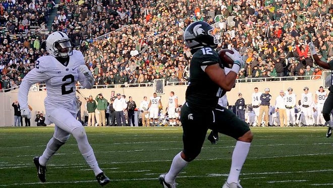 R.J. Shelton catches a pass from Connor Cook in the endzone in the first half against Penn State Saturday at Spartan Stadium in East Lansing