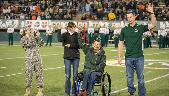 Veterans from the Wounded Warriors program were on field for a pre-game coin toss as honorary captains during a recent Military Day at a CSU football game.