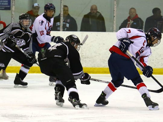 Livonia Franklin's Brendan Whitney (No. 7) looks to